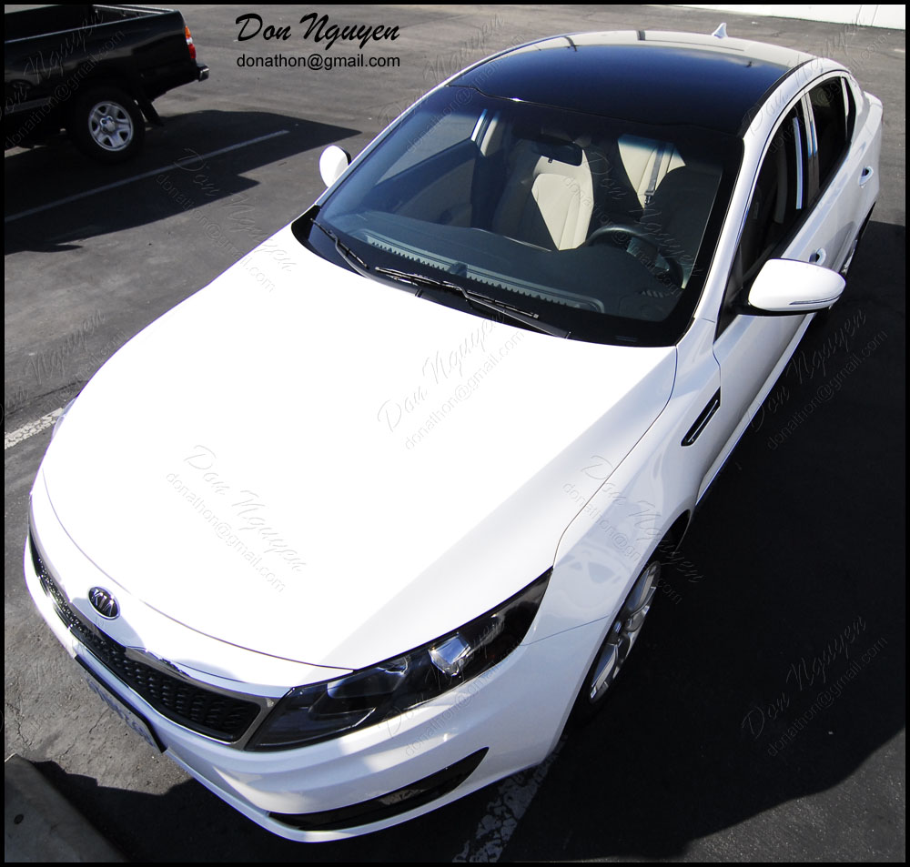 Don Nguyen Gloss Black Vinyl Wrapped Roof On A White Optima